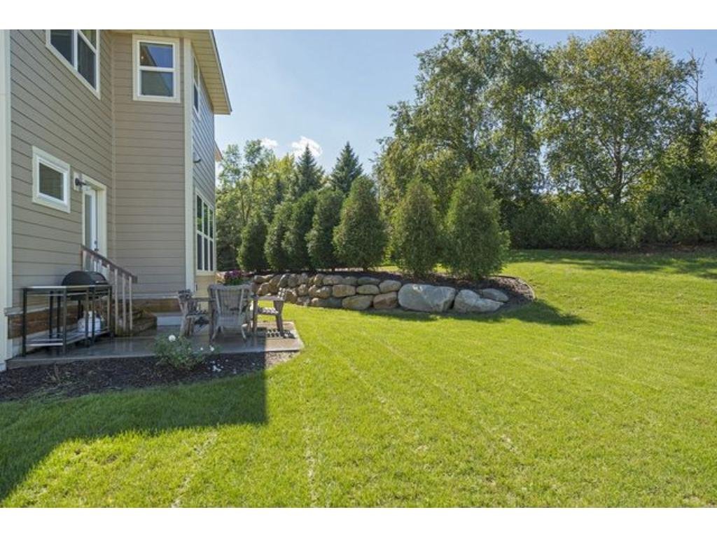 Enjoy views of mature landscaping in this backyard. Patio is the perfect place to entertain.