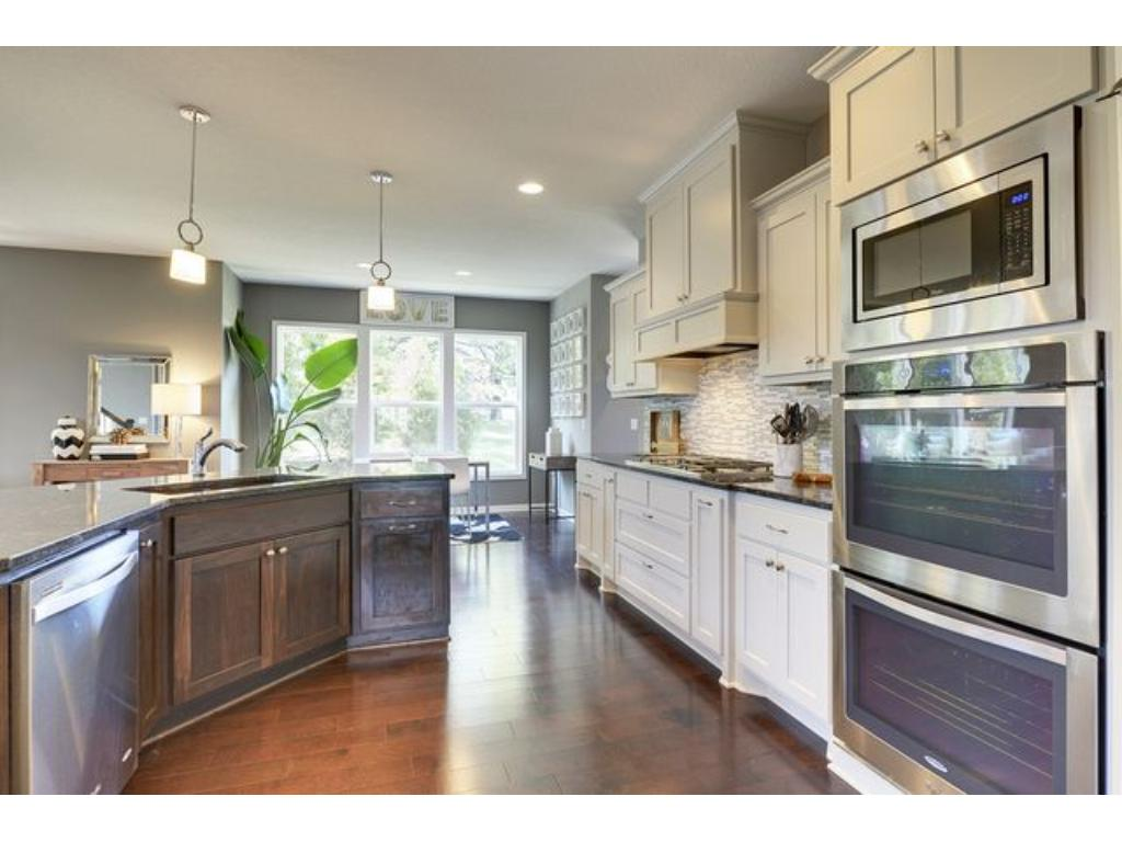 Feel like a chef in this fantastic gourmet kitchen. Granite counter tops, stainless steel appliances, modern back splash, double oven, walk-in pantry, and tons of storage space!