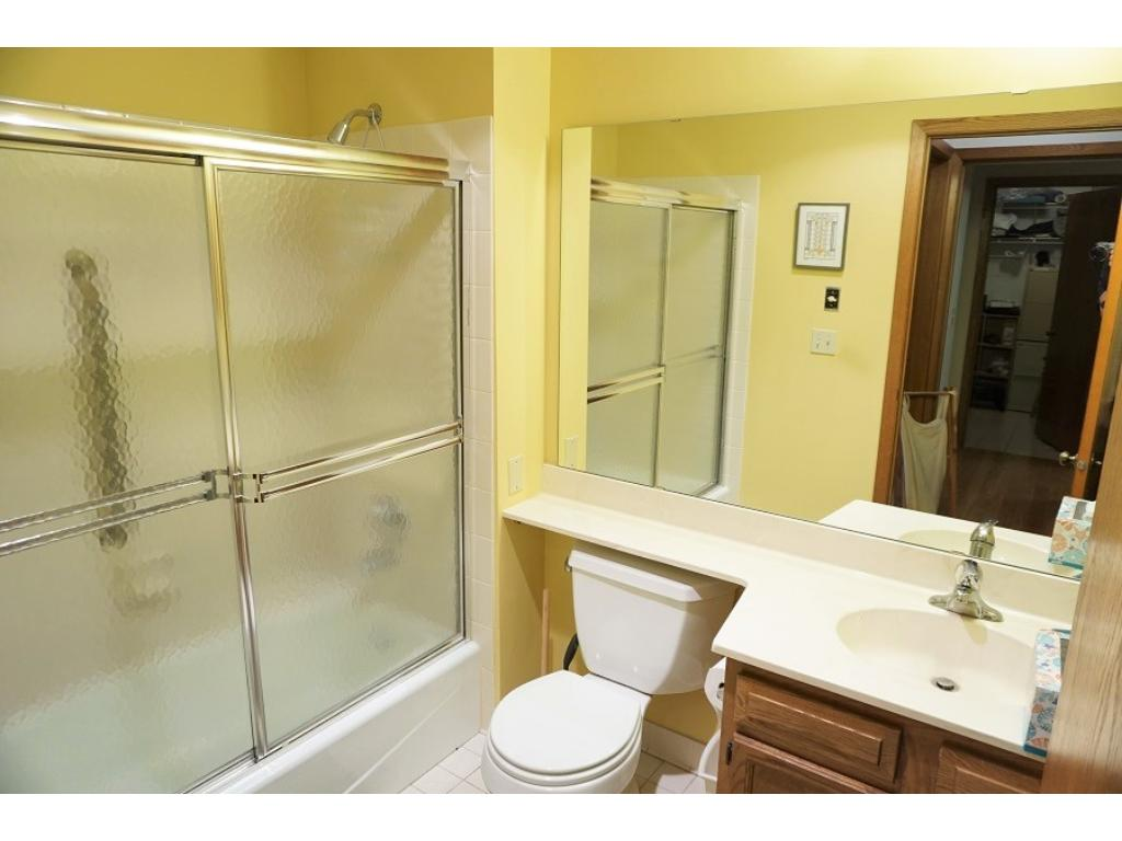 The full bath is adjacent to the second bedroom.