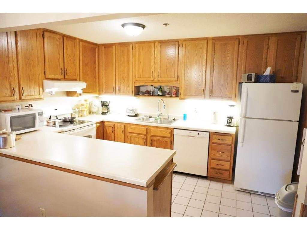 The light, bright kitchen is fully equipped and features lots of under cabinet lighting.