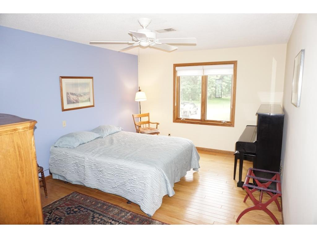 The master bedroom suite is HUGE and features...