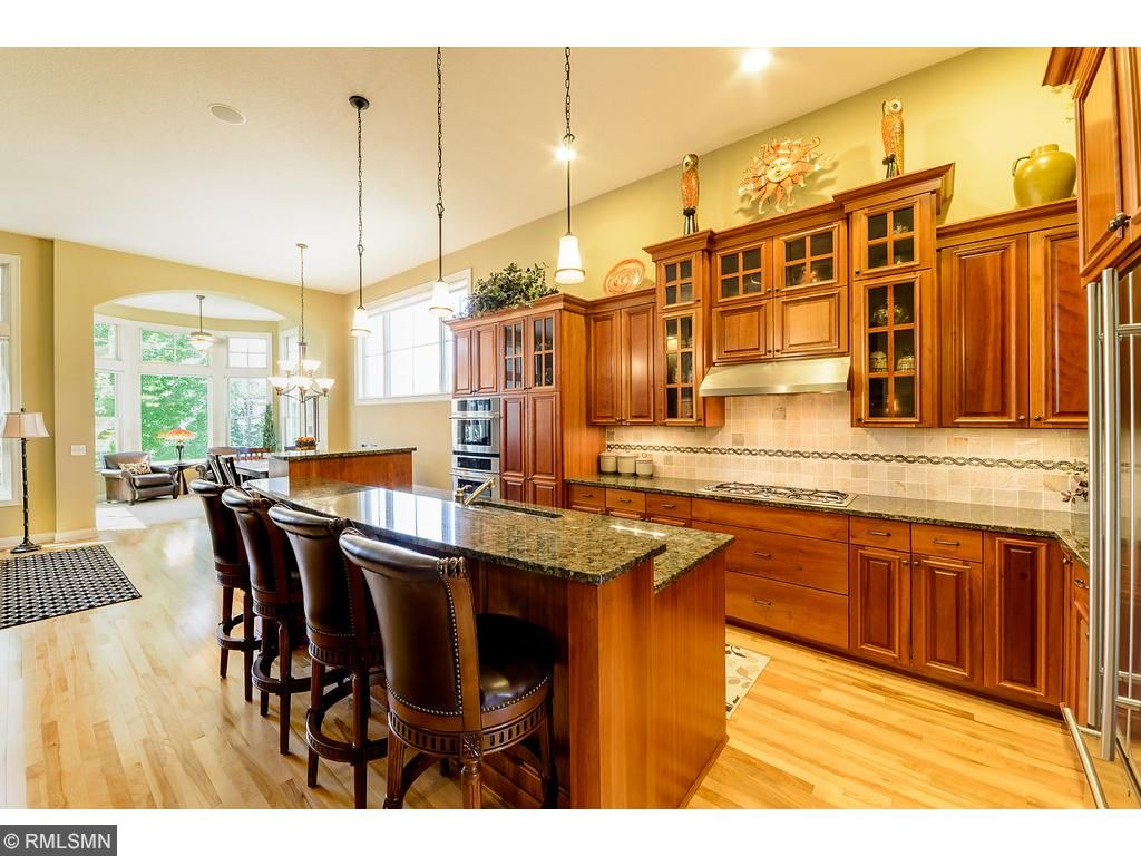 Gourmet...Galore! A Gourmet's Dream, come true.  Custom Cherry Cabinetry, Granite countertops, stainless steel appliances, expansive center island, coordinating backsplash..appointments that prove design, needed amenities and good taste can co-exist.