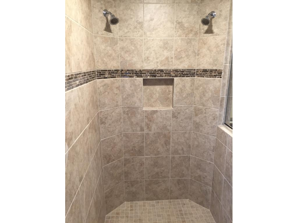 The serenity shower has two showerheads and a seat.