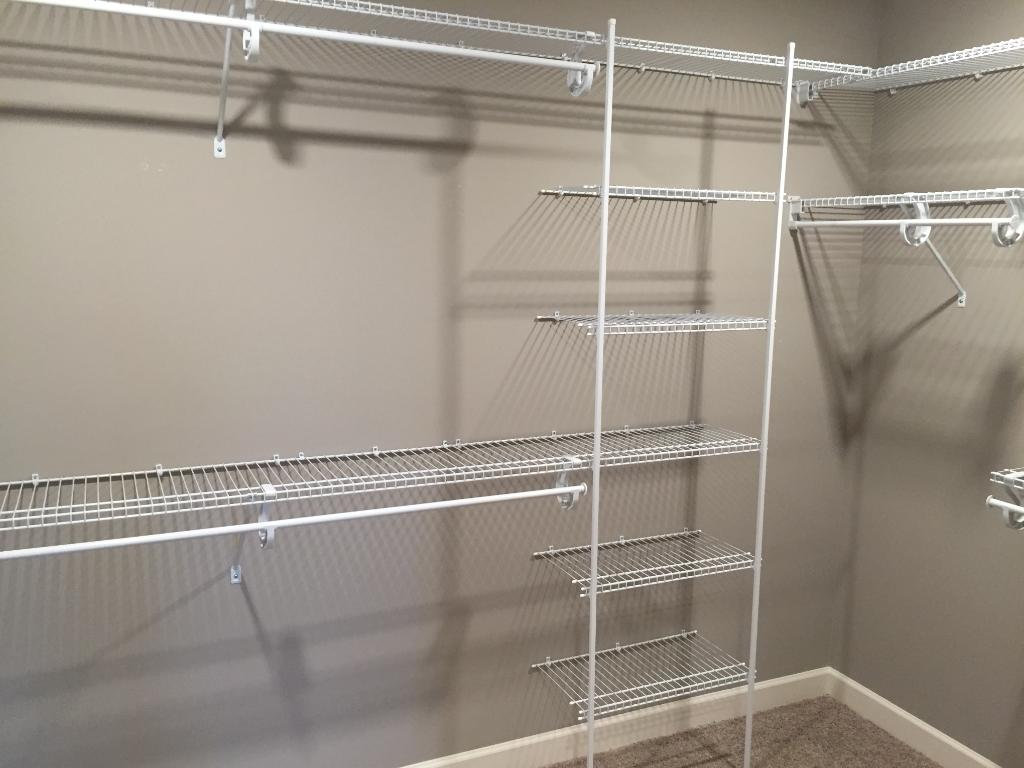The owners' walk-in closet is yet another large storage area in this home.