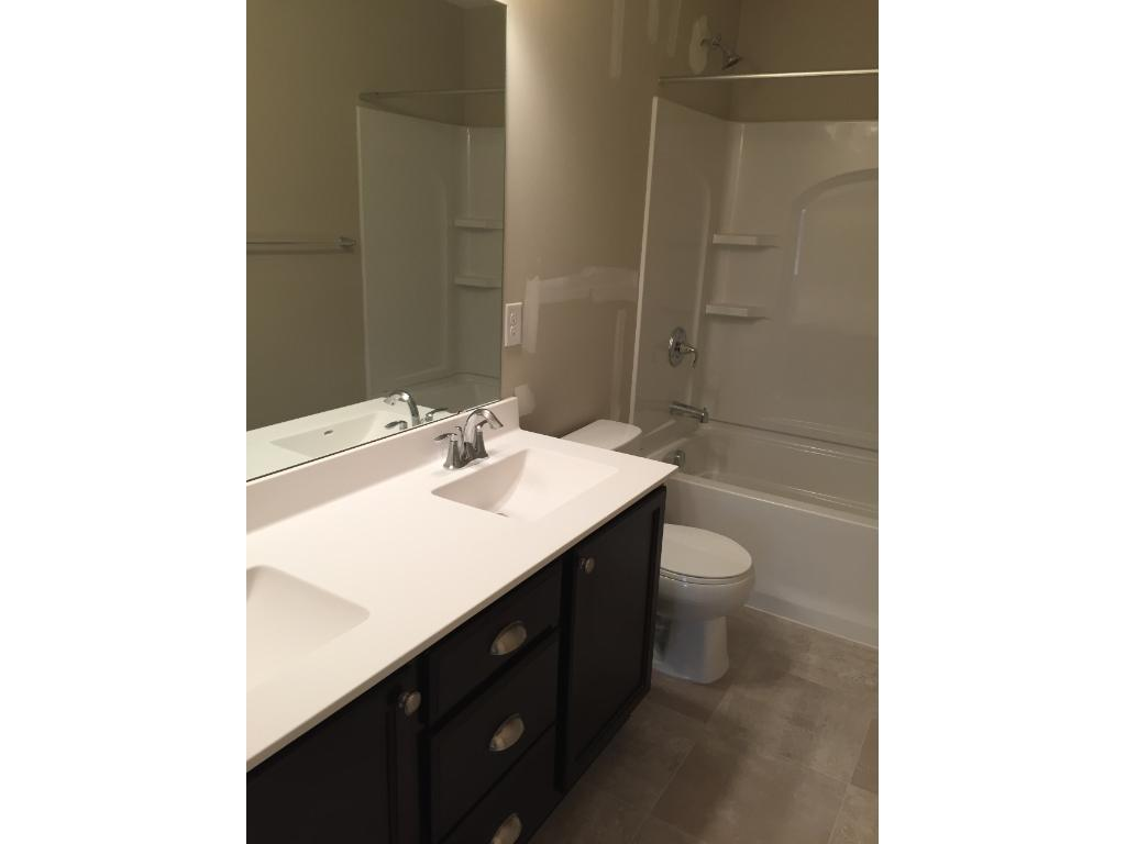 The upper level hall bath has a double vanity too.