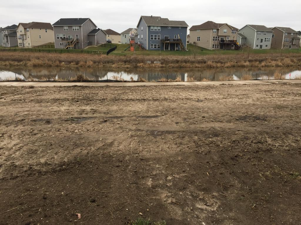 Large, flat backyard backing up to a pond! Full sod is included.