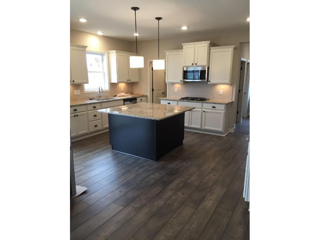 Gourmet kitchen with granite countertops and great workspace on that large center island; directly next to the kitchen is the informal dining room.