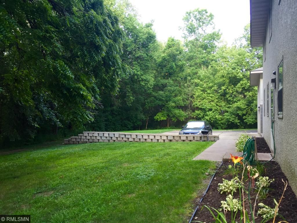 Private back yard overlooking wooded area near park.