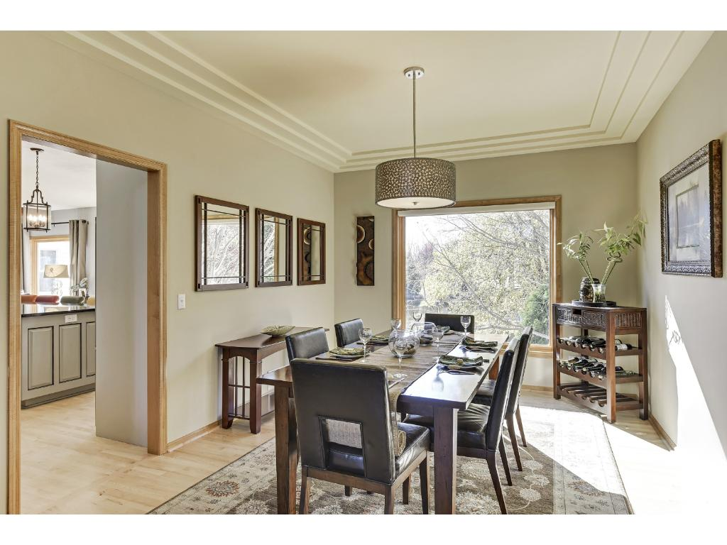 Elegant formal dining w/ new window overlooking private backyard.