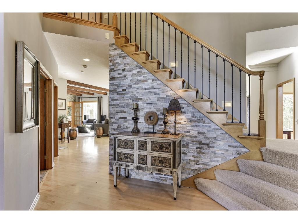 New staircase & stone accent to greet you as you enter the home.