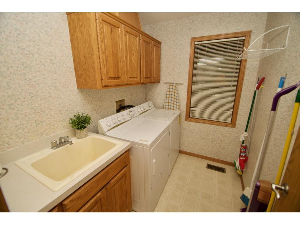 Laundry never looked so good!  Conveniently located off the mudroom, this spacious room has a utility sink, built-in cabinets, closet, window and washer/dryer that stay with the home.