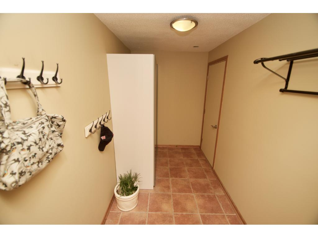 Wonderful mudroom with tile flooring off the garage area.