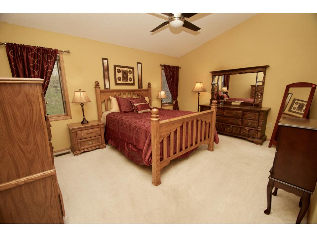 Large master suite with vaulted ceiling, ceiling fan, walk-in closet and private master bath.