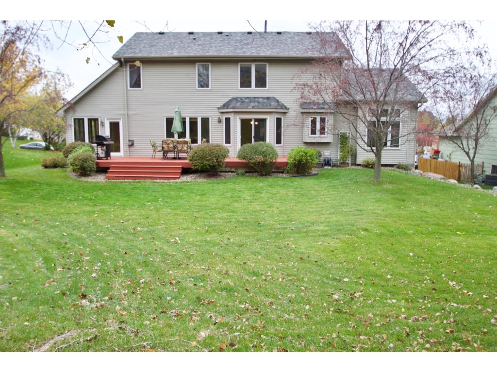 Beautiful spacious backyard with plenty distance between you and your backyard neighbor, fire pit area and nice deck...again...perfect set up for entertaining!!