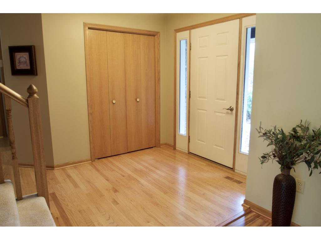 Inviting and spacious foyer to greet your guests.  Nice open feel, front closet and real wood flooring.