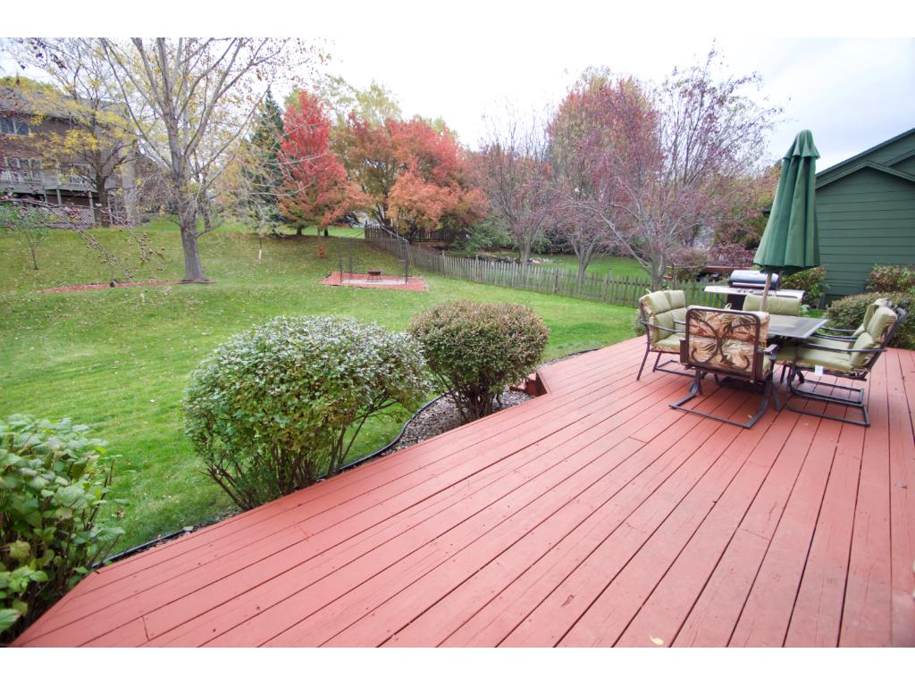 Enjoy sitting and relaxing on your large deck with wide steps leading to the large back yard.