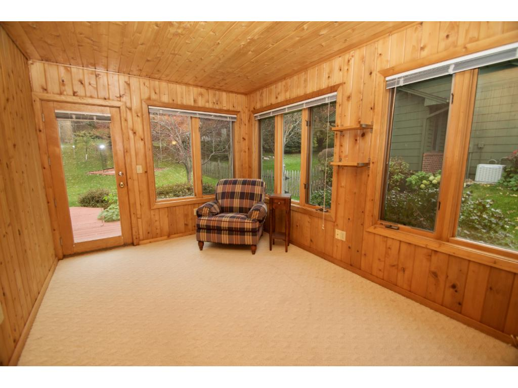 Cozy 3 season porch with access to the deck and backyard.