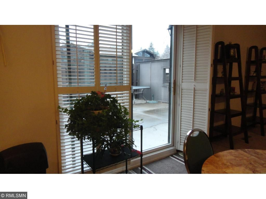 Plantation shutters lead out to private patio