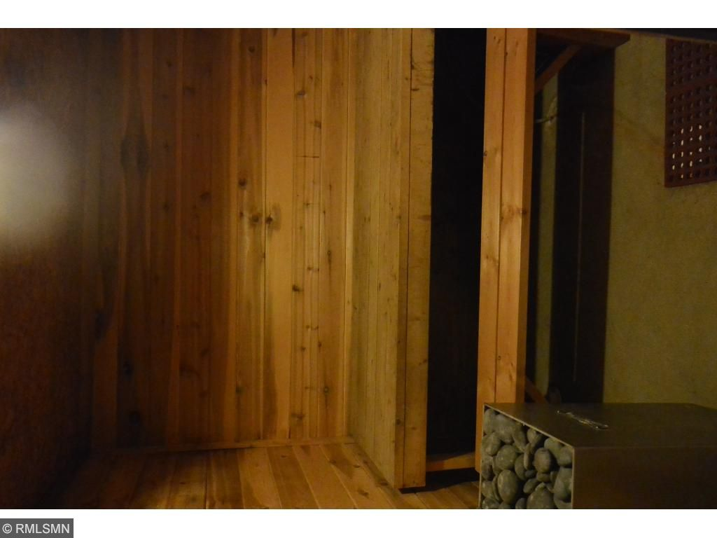 Sauna with shower in lower level