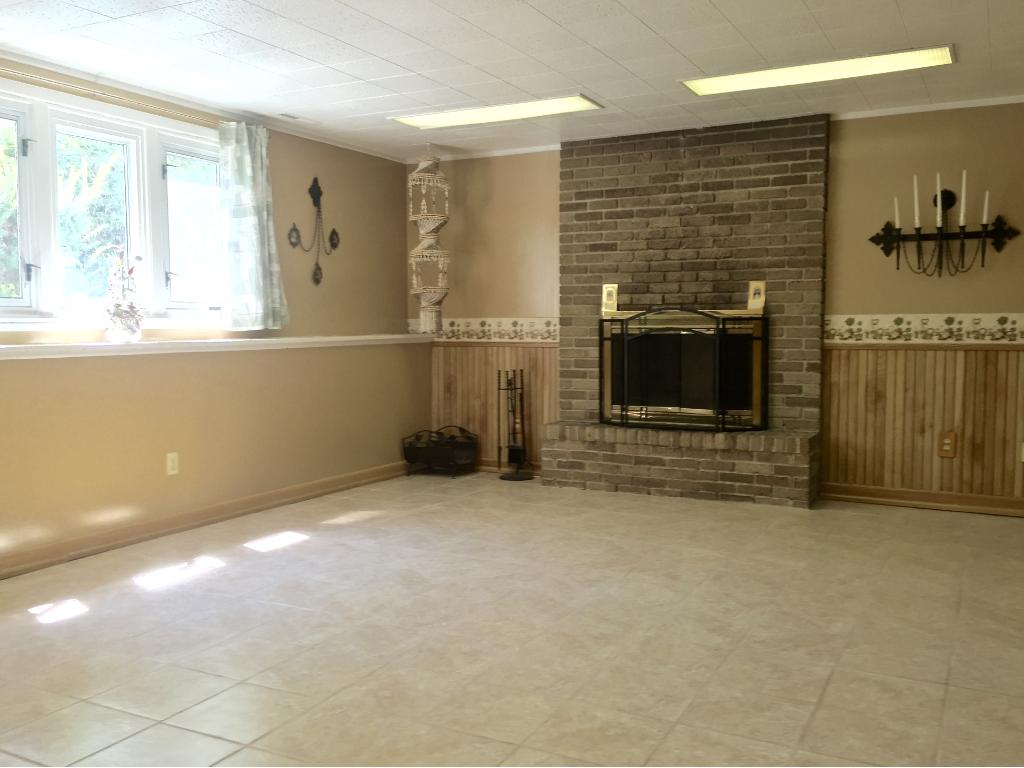 The lower level has been completely remodeled into a very large family room with full size windows.