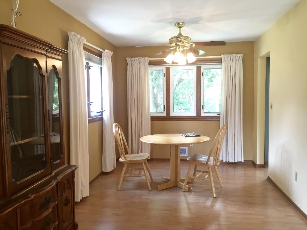 The adjacent formal dining area has a new ceiling fan and light fixture. All window treatments are included.