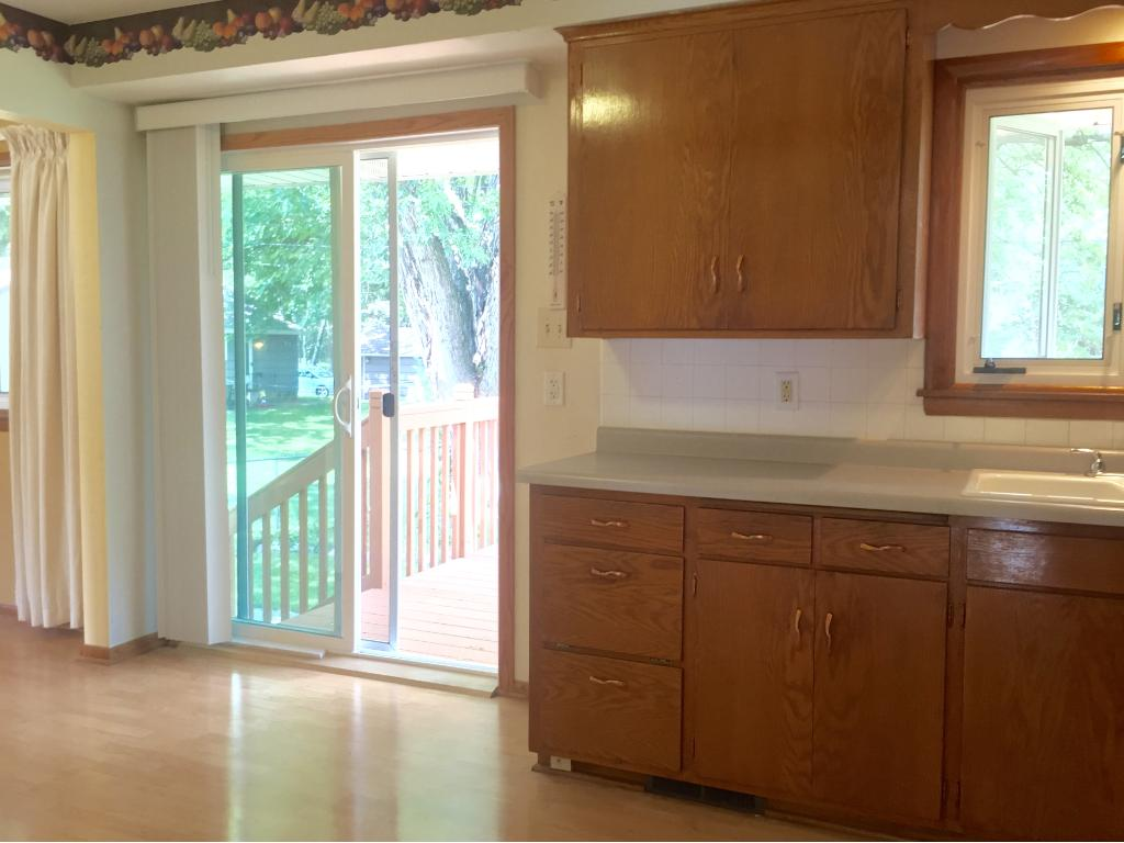 A new sliding door opens the kitchen to a beautiful new deck- added in 2015.