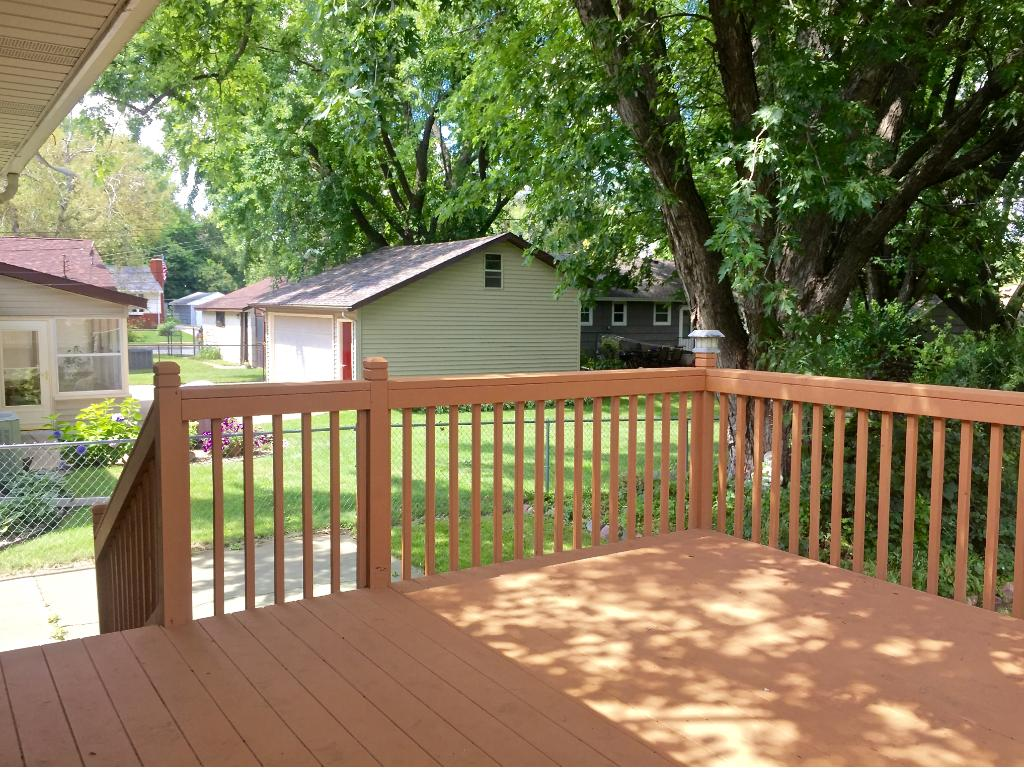 The large deck is perfect for entertaining. Just down the steps, the concrete patio is an added bonus.