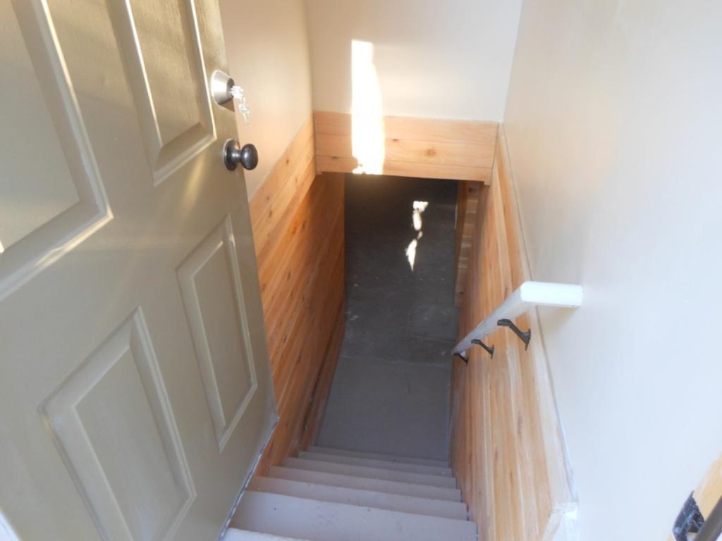 Outside entrance to basement/lower level.