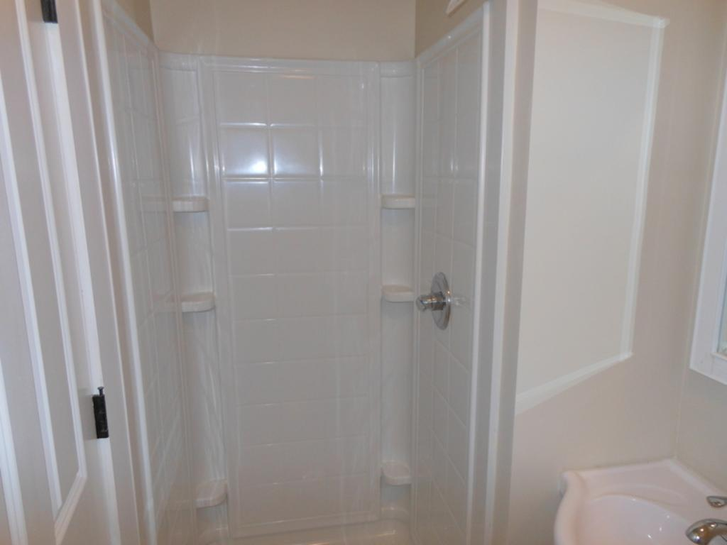Main floor bathroom with shower surround.