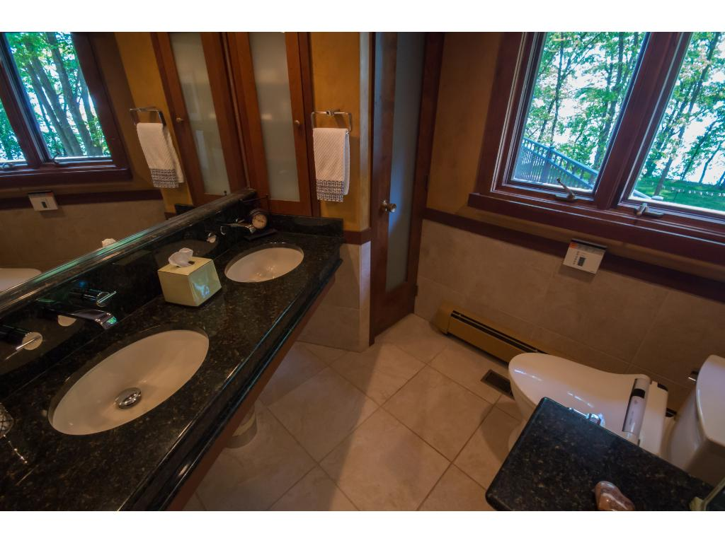 A dual vanity and plenty of linen space in the owner's bathroom!