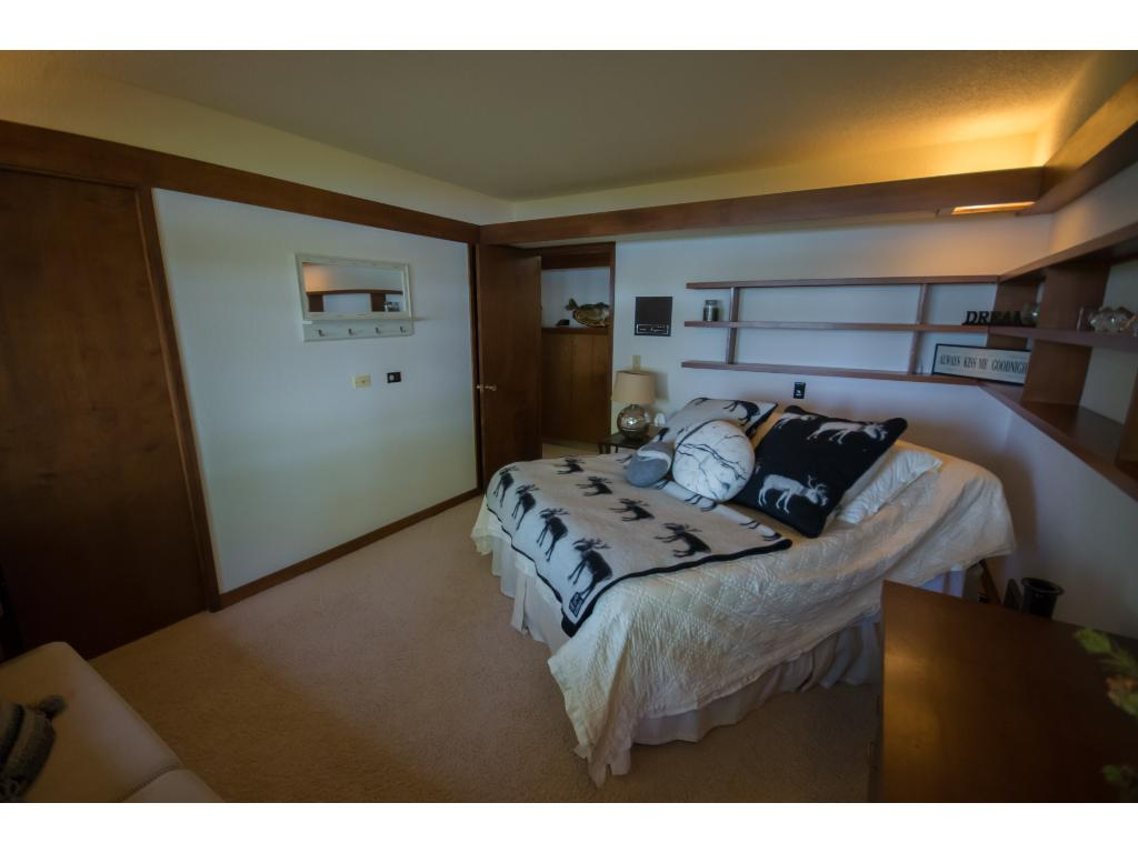 A second main level bedroom with gorgeous views of the lake.