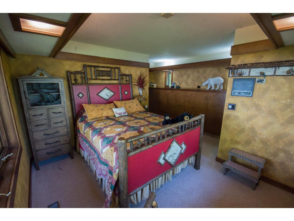 "The ""bear"" room is at the end of the wing and has a great view of the point overlooking Lake Menomin."