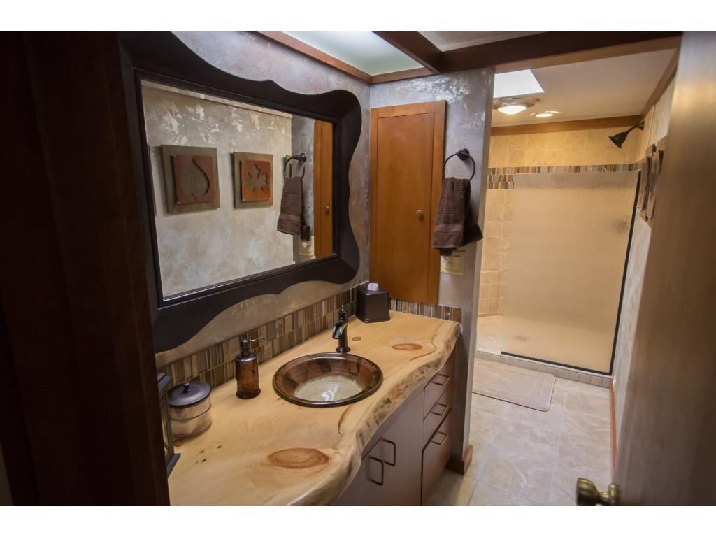 Custom vanity and tile work in this large main level bathroom.