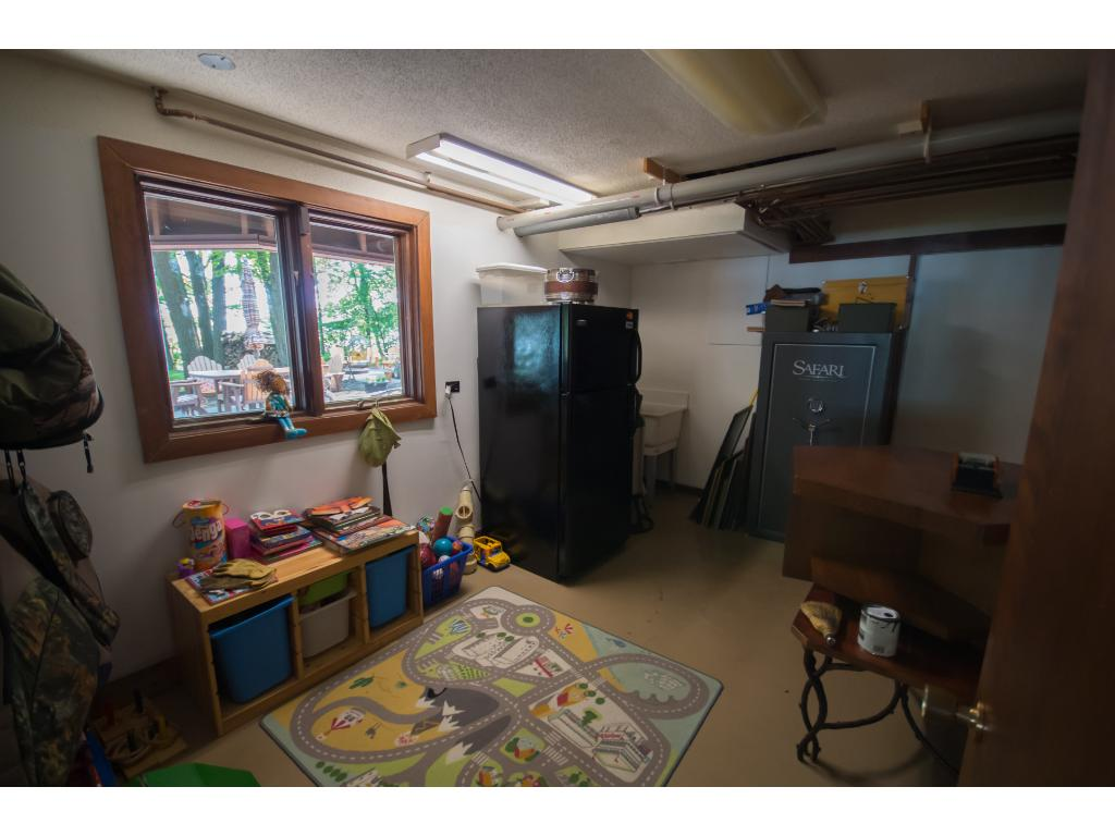 This huge main level storage room could easily be converted into an office or laundry room!