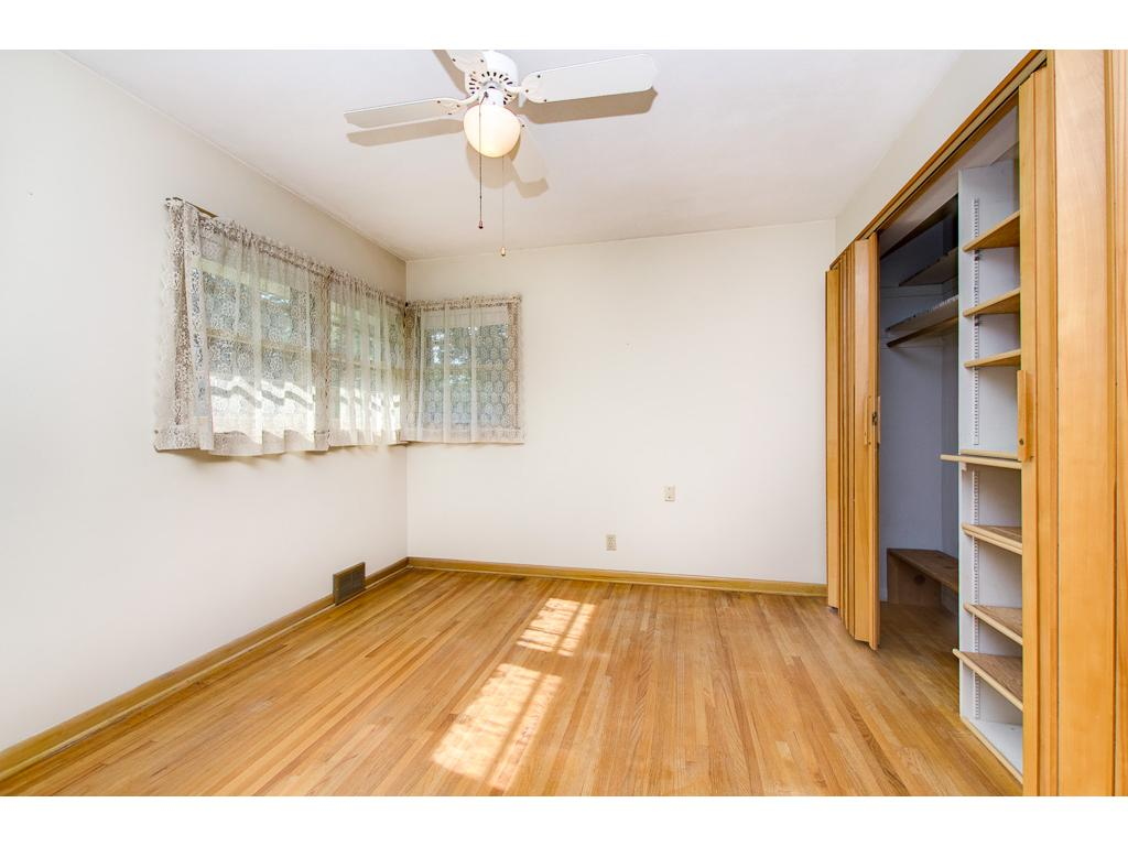 Nice Main Floor Master Bedroom Features Beautiful Hardwood Floors, Corner Windows and a Wall of Closets
