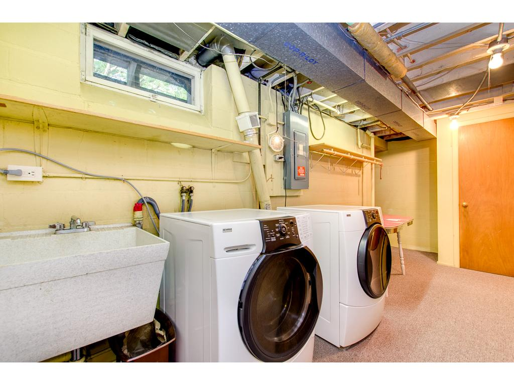 Large Laundry Area Has Tons of Storage and Features Very Nice Front Loading Appliances
