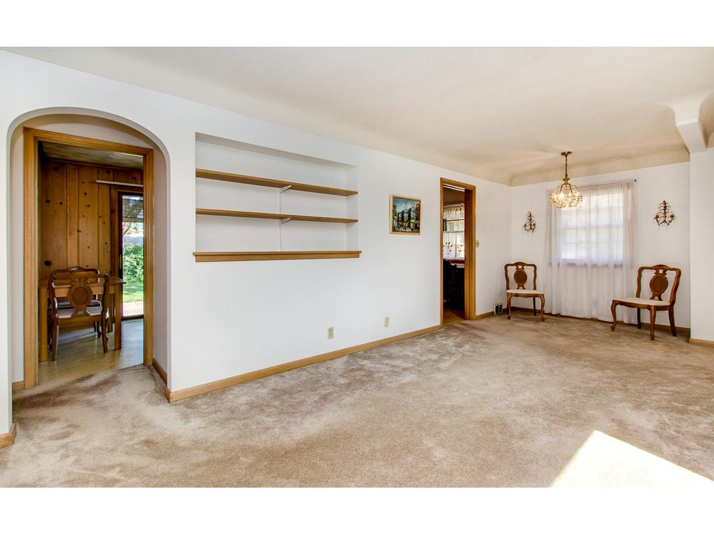 Large Formal Living Room With Formal Dining Off The Kitchen--Hardwood Floors Under The Carpet
