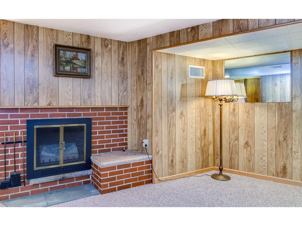 Handsome Brick Wood Burning Fireplace in the Family Room
