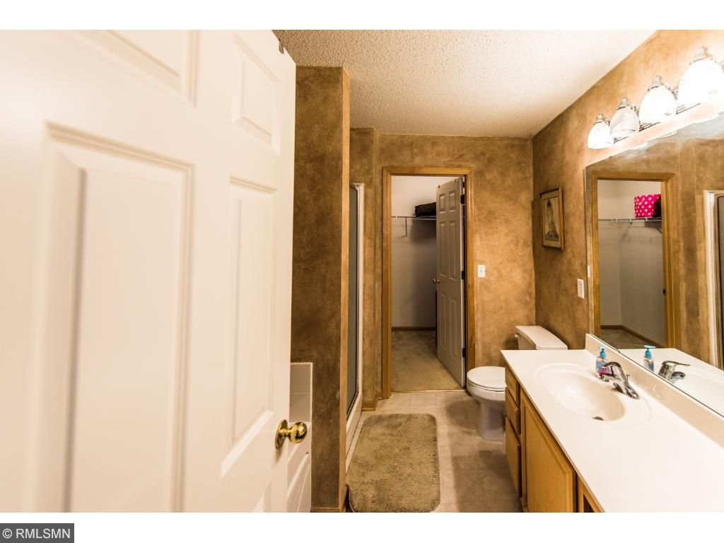 Master bath has large vanity, Tub, shower and walk-in closet.