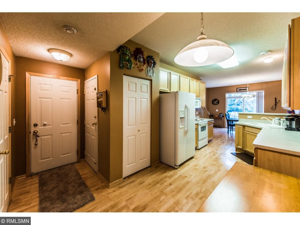 Spacious kitchen and great storage next to entrance to garage. There is also a half bath on this level.