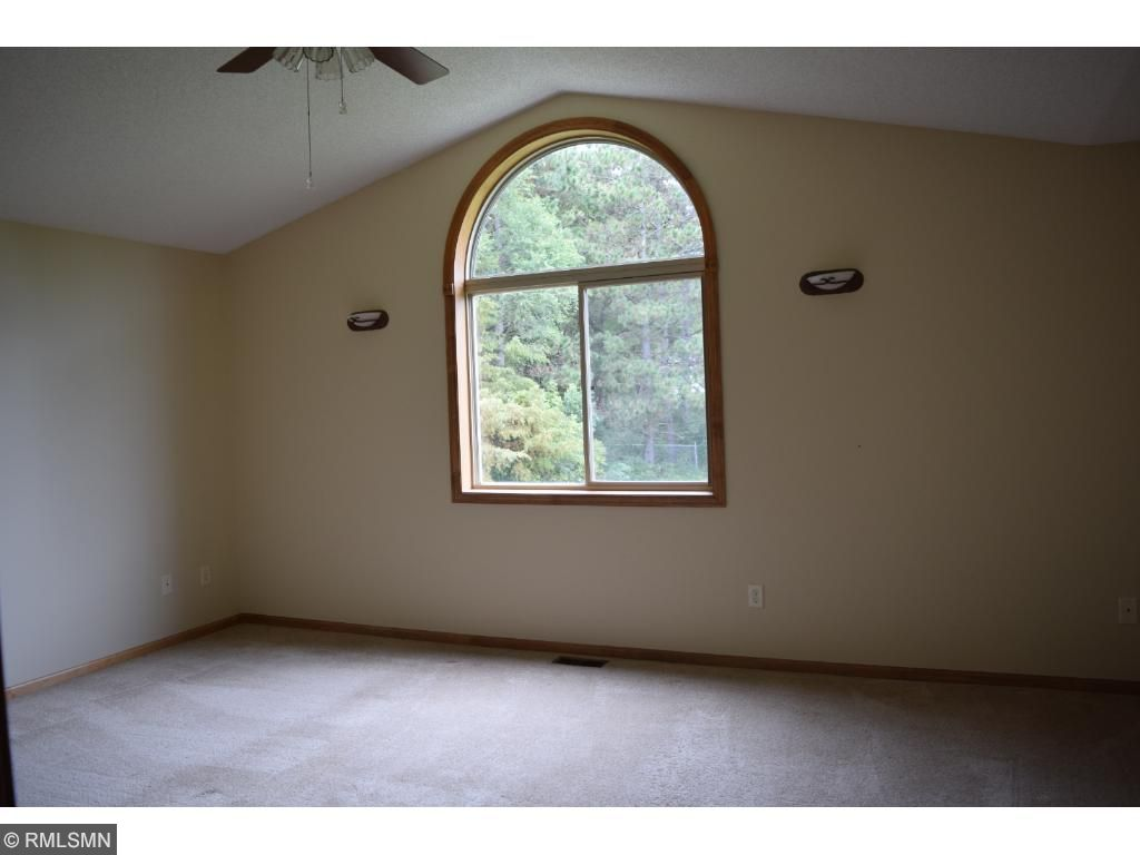 Large Bedroom with vaulted ceiling and walk-in closet