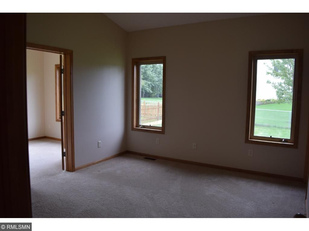 Main level bedroom with sunroom and large walk-in closet