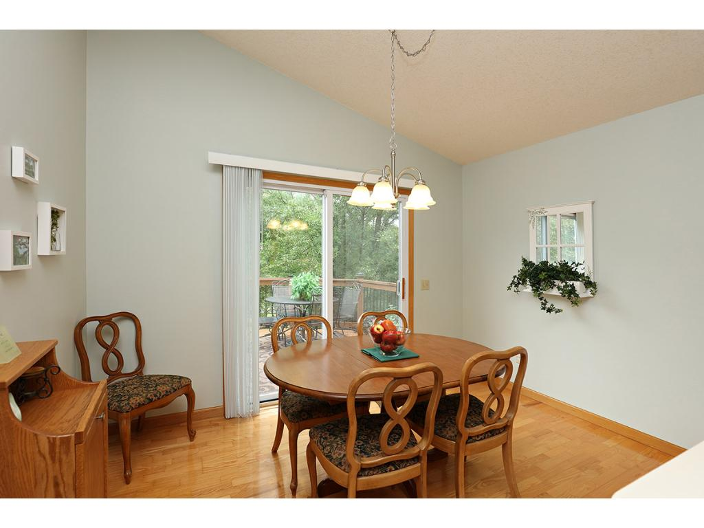 Spacious Dinette offers Vaulted Ceiling and Sliding Glass Door Walkout to the Deck.