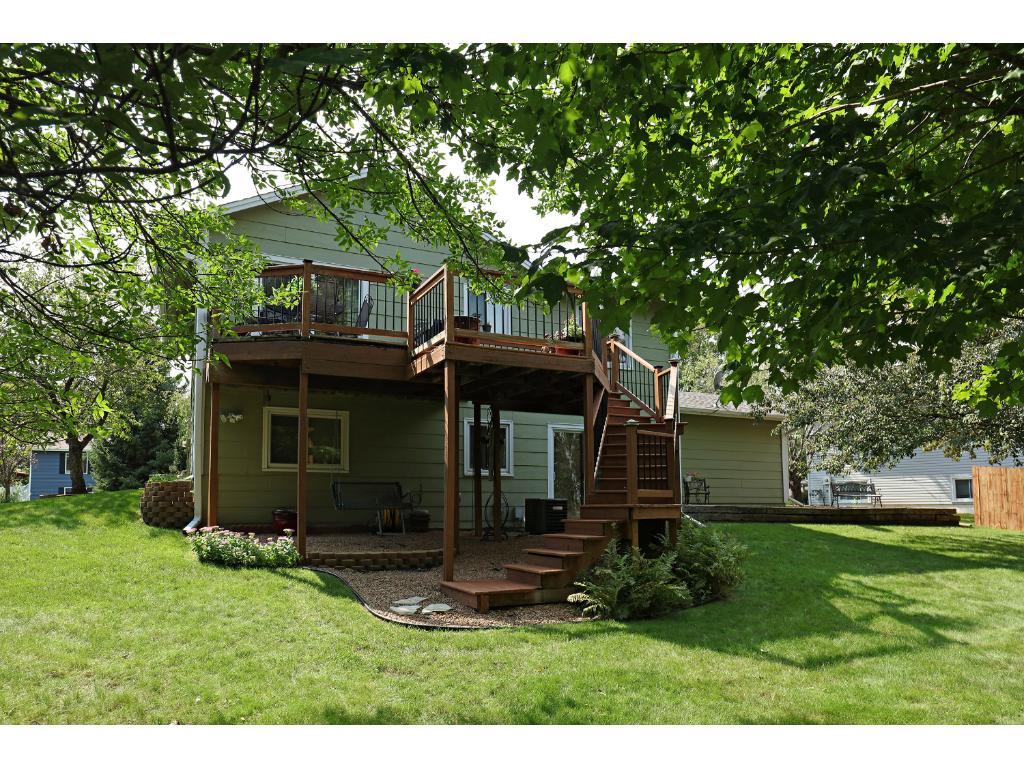 Spacious two-tiered Deck with steps to Large Back Yard, Enjoy the sounds and views of Nature.