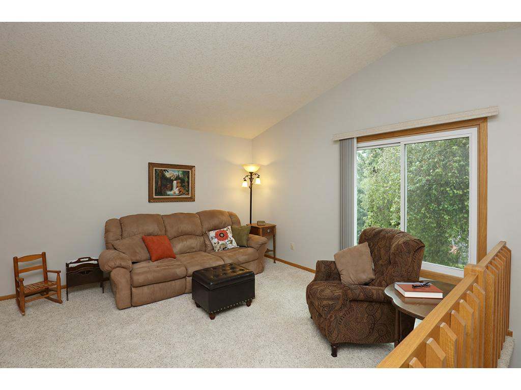 Living Room Boasts Vaulted Ceilings and a Large Bright Front Facing Window!