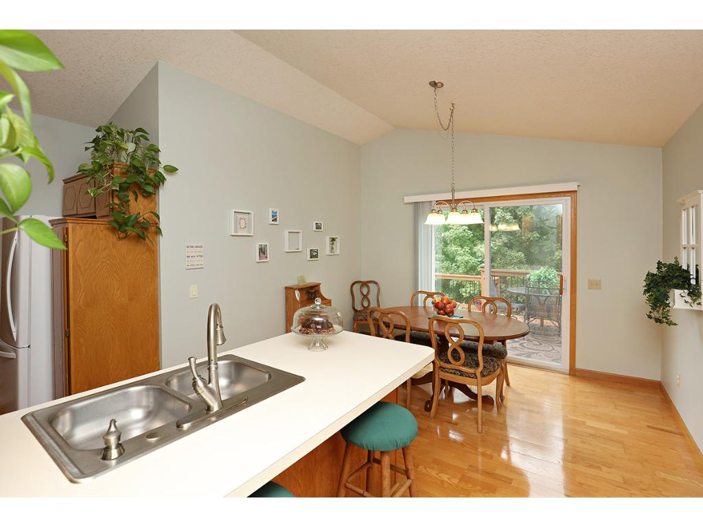 Easy Flowing Floor Plan Combines the Kitchen and Dining Rooms on the Quality Laminate Floors.