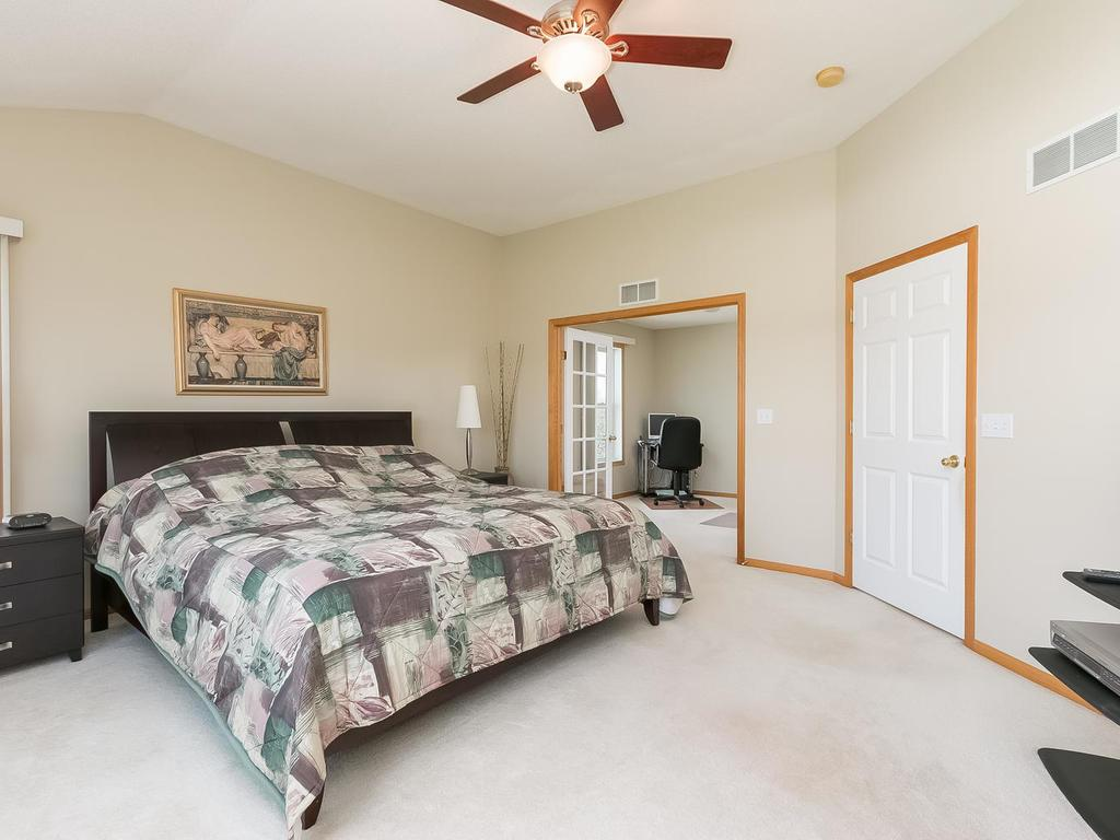 Another view of the master bedroom showing the entrance to the adjacent sitting room.