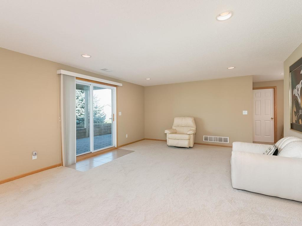 Spacious walkout lower level family / amusement room. The lower level also has an exercise room, a three quarter bath and another bedroom.