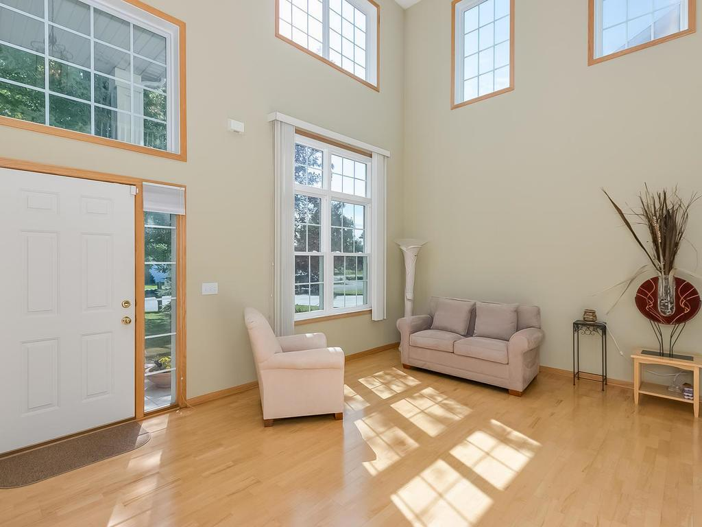Spacious living room with two story ceiling.