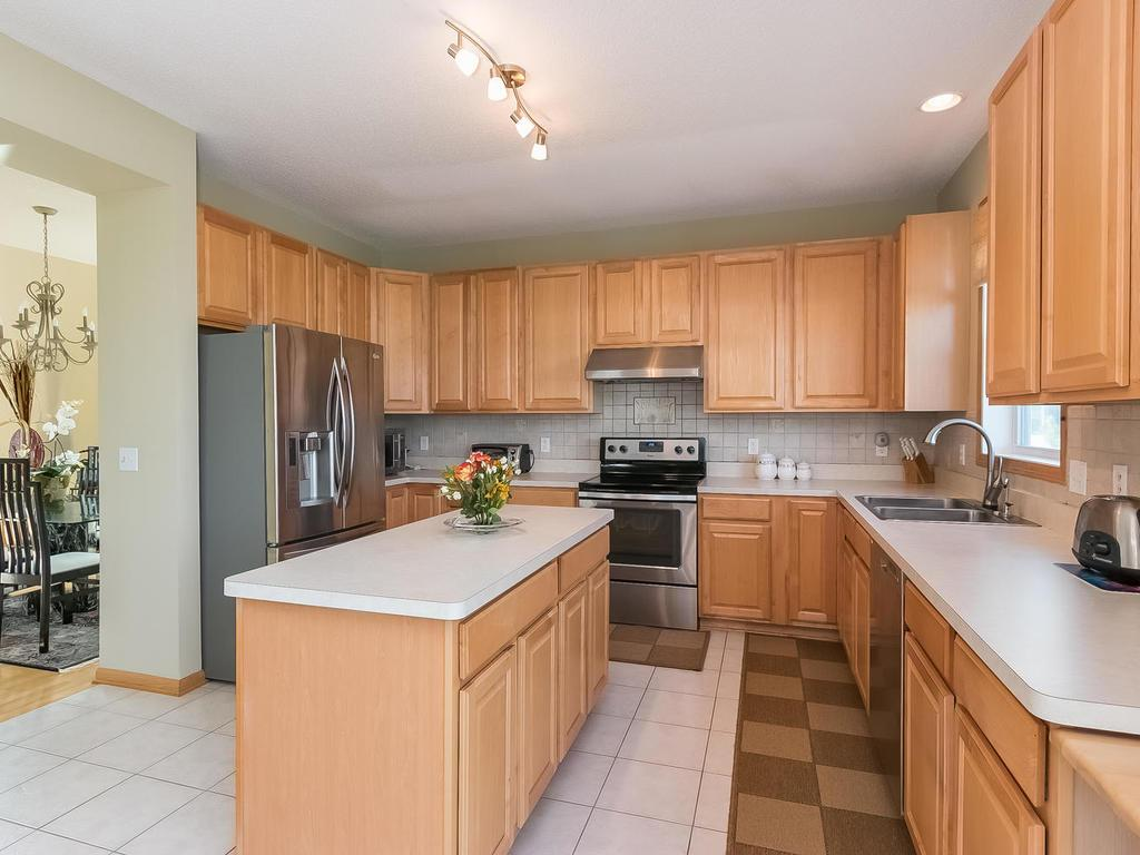 Large kitchen area with all new appliances and an abundance of cabinets and countertop space plus a center island.